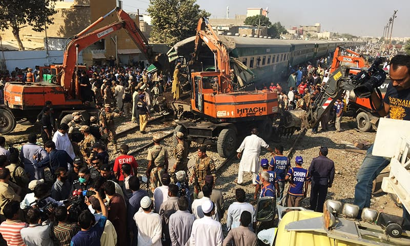 Rescuers workers use heavy machinery on the car of a train which crashed outside Karachi, Pakistan November 3, 2016. REUTERS/Akhtar Soomro