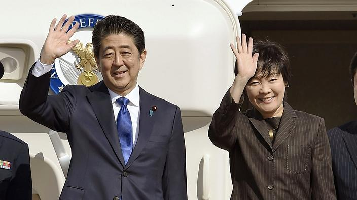 Japanese Prime Minister Shinzo Abe and his wife Akie wave prior to their departure to New York, at Haneda airport in Tokyo Thursday, Nov. 17, 2016. Abe plans to meet with President-elect Donald Trump on Thursday in New York. (Takuto Kaneko/Kyodo News via AP)