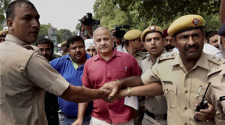New Delhi: Police detain Delhi Deputy Chief Minister Manish Sisodia and other AAP MLAs at Tughlaq Road Police Station during their march towards Prime Minister's residence to protest against the arrest of party legislator Dinesh Mohaniya, in New Delhi on Sunday. PTI Photo by Kamal Singh (PTI6_26_2016_000068B)