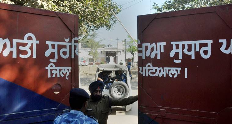 Nabha: Rapid Action Force men at Nabha Central Jail, which was stormed by armed men who helped in escaping six terrorists including Khalistan Liberation Front chief Harminder Mintoo, in Nabha on Sunday. PTI Photo(PTI11_27_2016_000101B)
