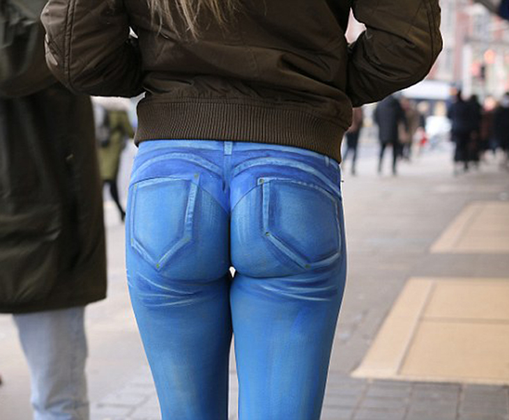 Model Parades Up And Down A Street In Spray-Painted Jeans