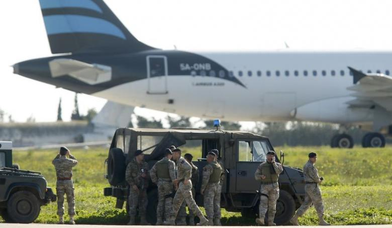 Maltese troops survey a hijacked Libyan Afriqiyah Airways Airbus A320 on the runway at Malta Airport, December 23, 2016. REUTERS/Darrin Zamit-Lupi