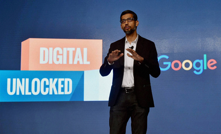 Google CEO addressing an event in New Delhi